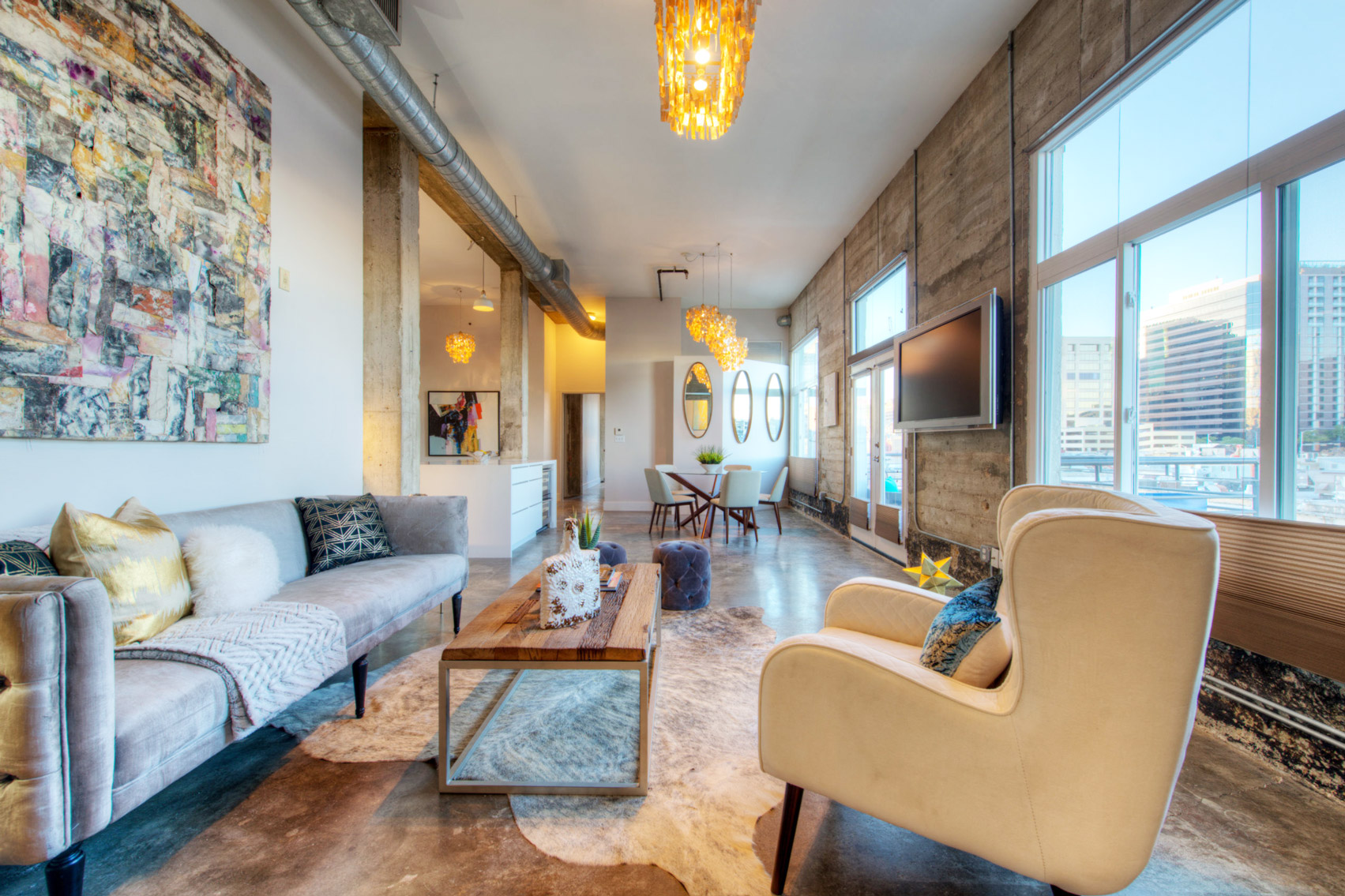 Elite austin interior design texas eclectic loft living room elite austin Home furniture rental austin texas