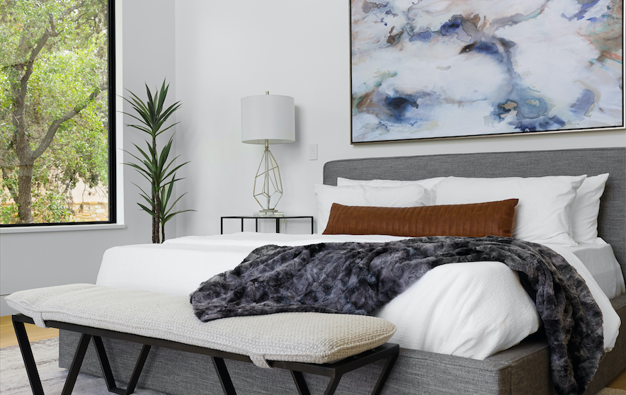 Horseshoe Bay Home Primary Bedroom staged by Elite Austin